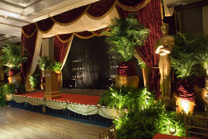 Soup to nuts service: from the plants to the drapes to the custom gold urns.