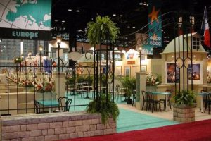 Plants create an oasis feel, both at the entrance and along the many aisles of a multicultural food show.
