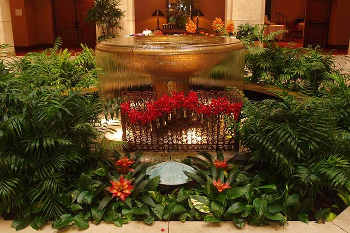 Live plants create a beautiful focal point in the lobby of a hotel or commercial building.