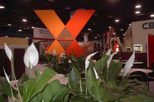 Enhance your trade show space with live plants that welcome visitors to your booth.