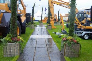 Colorful plants are used to accentuate the equipment display.
