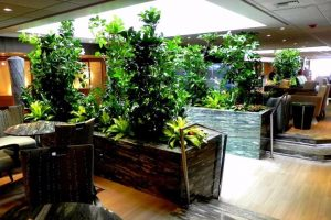 Used as natural dividers, plants create intimate, private meeting spaces in a larger room.