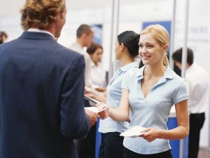 smiling at a trade show